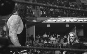 Legacy (Ryder & Dibiase) vs Undertaker & ???  112