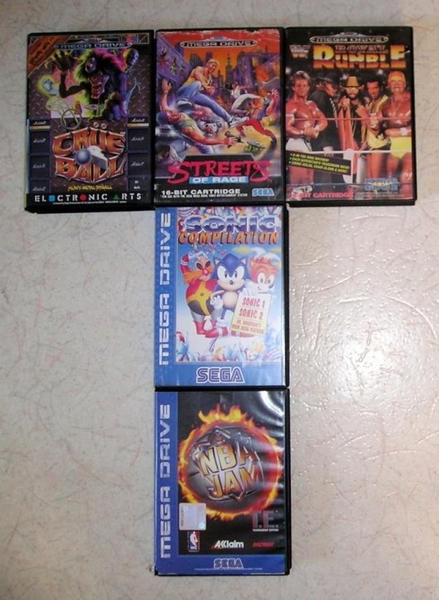 [Loterie] 5 jeux MegaDrive ou un Artbook World of Warcraft à gagner ! P1010019