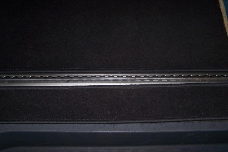 les Caches en caoutchuc des glissières 100_3717