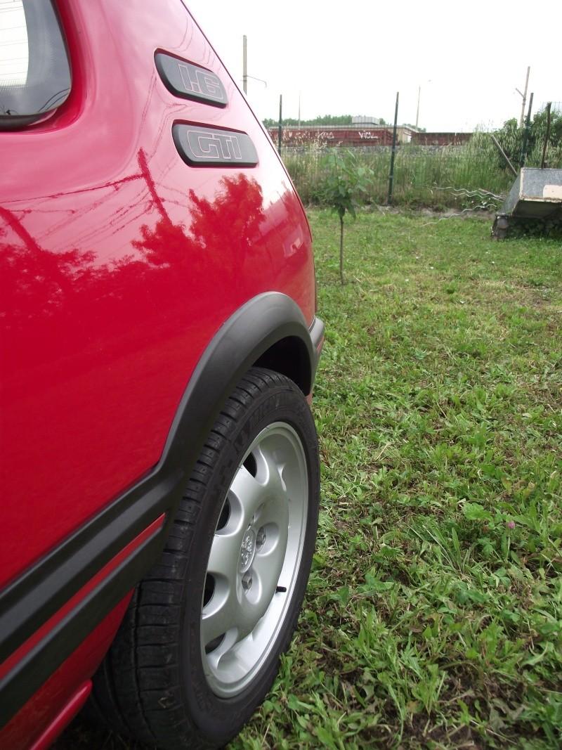 [David84] 205 GTI 1.6L 115cv Rouge Vallelunga 1992 - Page 5 Dscf2461