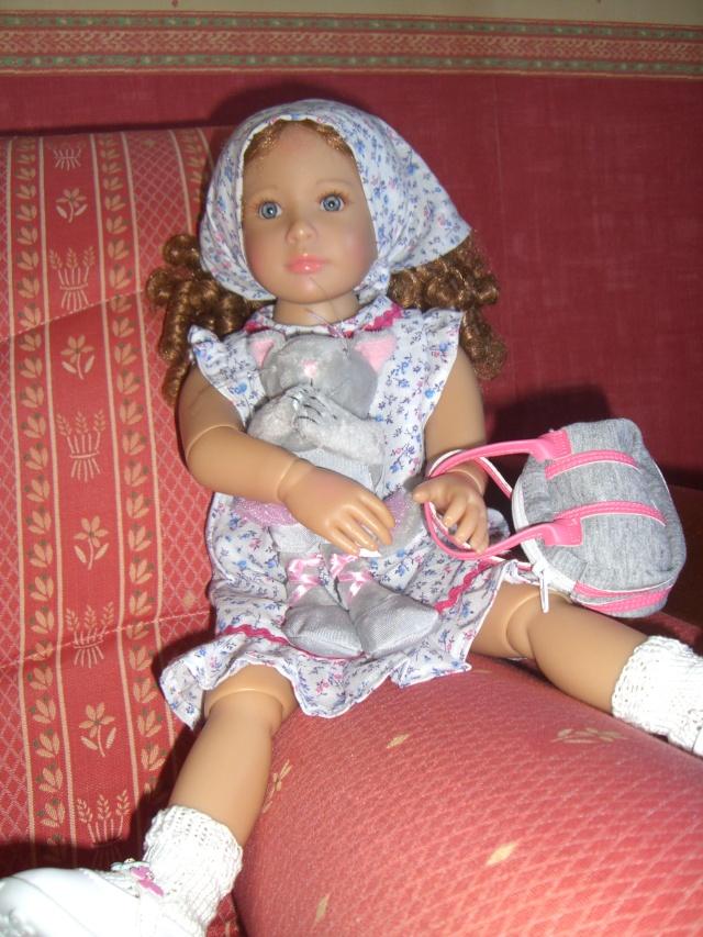 De nouveaux habits pour un mélange de poupées. Cimg5227