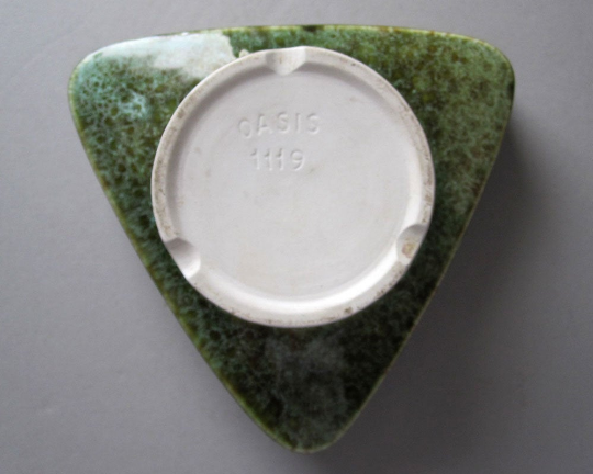 Triangle shaped dish marked Oasis Triang10