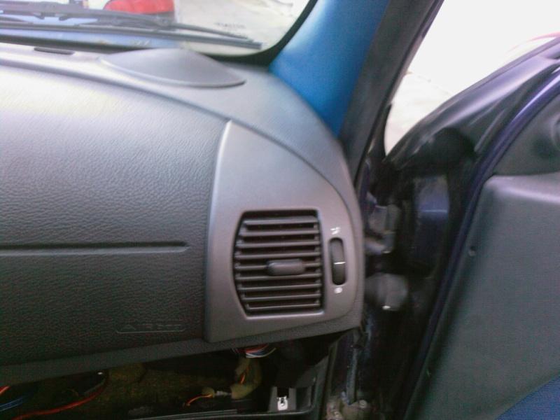 comment demonter le cache de radiateur passager Photos23