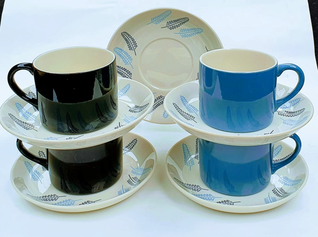Coffee Cans with blue and black leaves on the saucers Coffee10