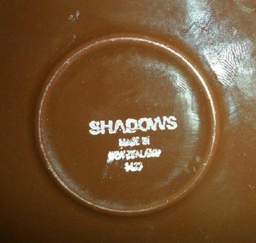 Shadows d422 has a brown base. Shadow11