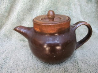 The Ferret asks if this is a Stables Pottery teapot?  No it isn't their mark and work. Stable10