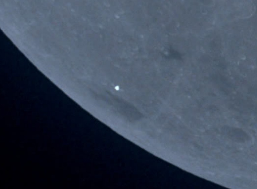 AS10-35-5249 Luminous UFO near the Moon As10-310