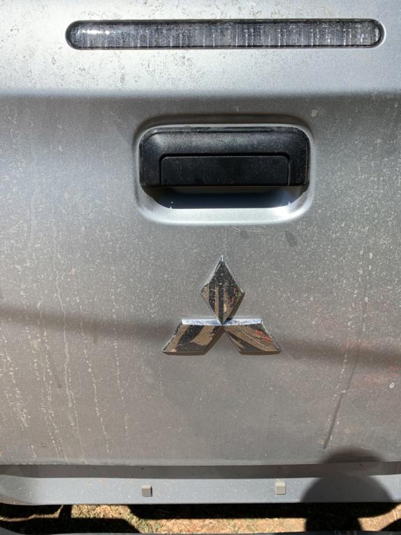 No puedo cerrar la puerta del pick up l200 4x2  F3160410