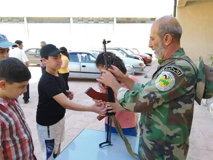 في تجاوز جديد لقرارات الأمم المتحدة بشار يدرب أطفال سوريا على السلاح E721f310