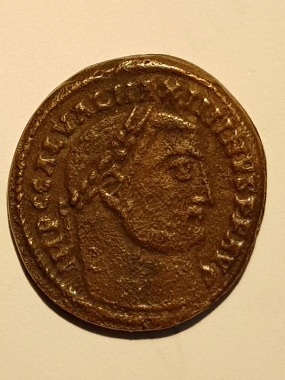 Nummus de Maximino II Daza. GENIO IMPERATORIS. Genio estante a izq. Alejandría. Anvers11
