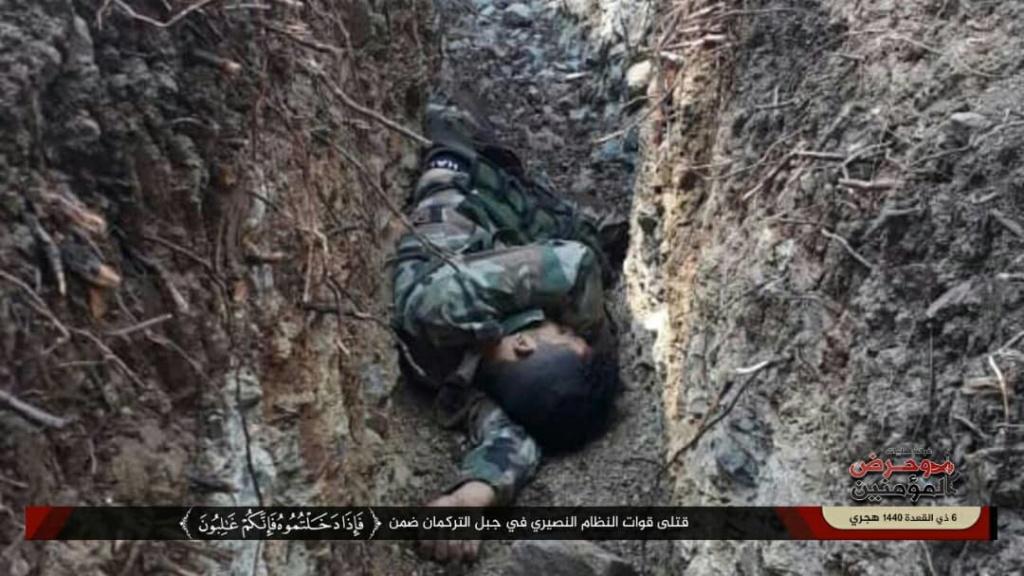 بالصور قتلى واسرى الشبيحة  بيد الجيش الحر9/7 91725910