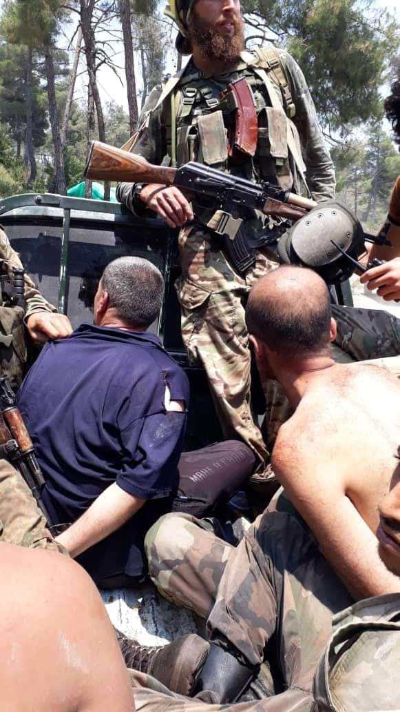 بالصور قتلى واسرى الشبيحة  بيد الجيش الحر9/7 C4605a10