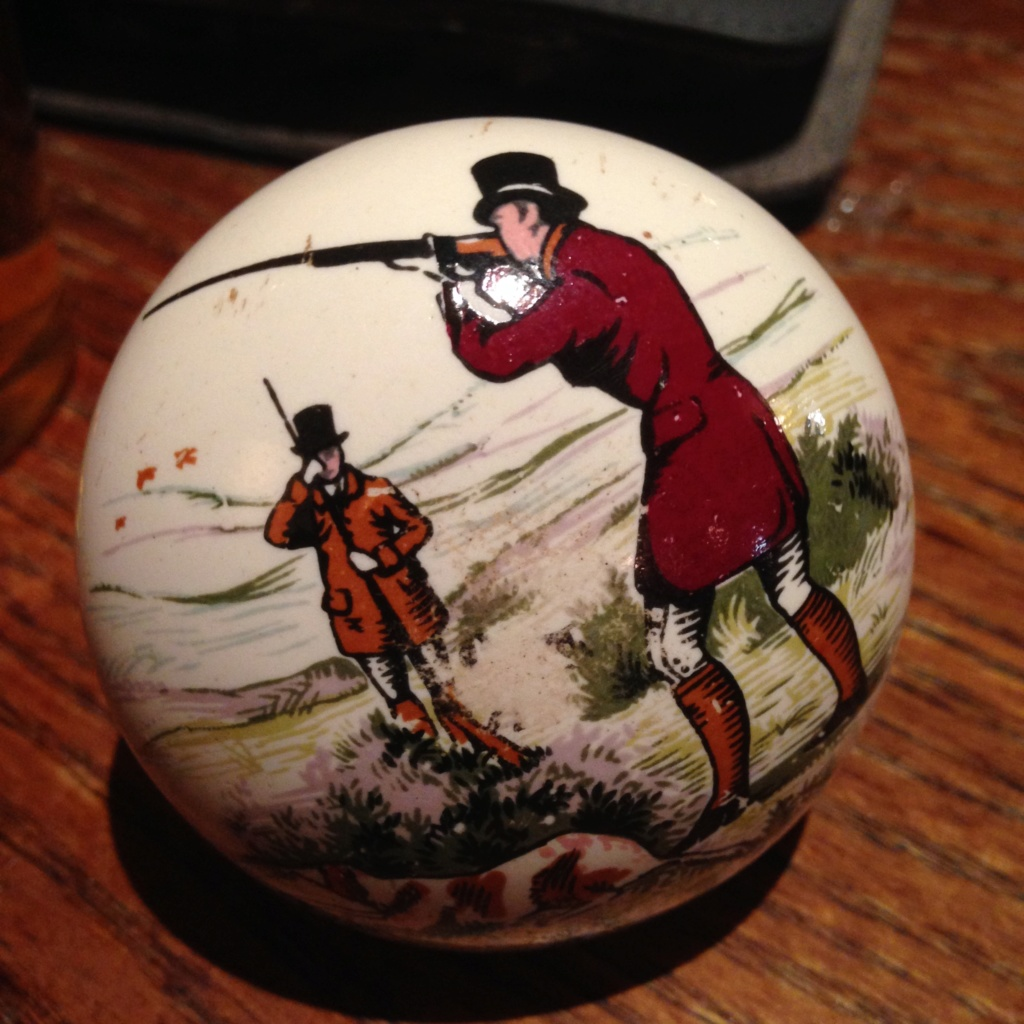 Surprisingly heavy China door knob with hunting shooting scene Img_2411