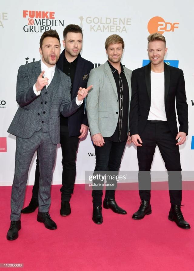 Westlife en la alfombra roja de los Golden Camera Award Gettyi13