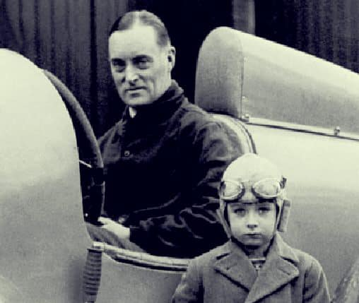 Sir Malcolm Campbell in uniform and on his Triumph, somewhere in London. 58978310