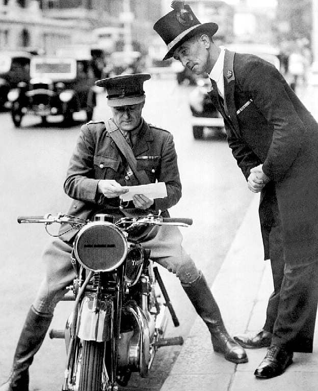 Sir Malcolm Campbell in uniform and on his Triumph, somewhere in London. 59714710