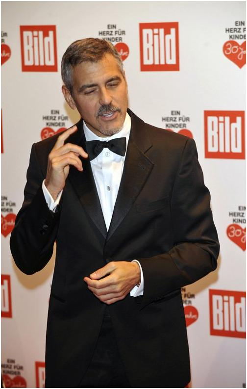 George Clooney in Berlin at the Ein Herz Fuer Kinder charity gala. December 2008 06-12_12