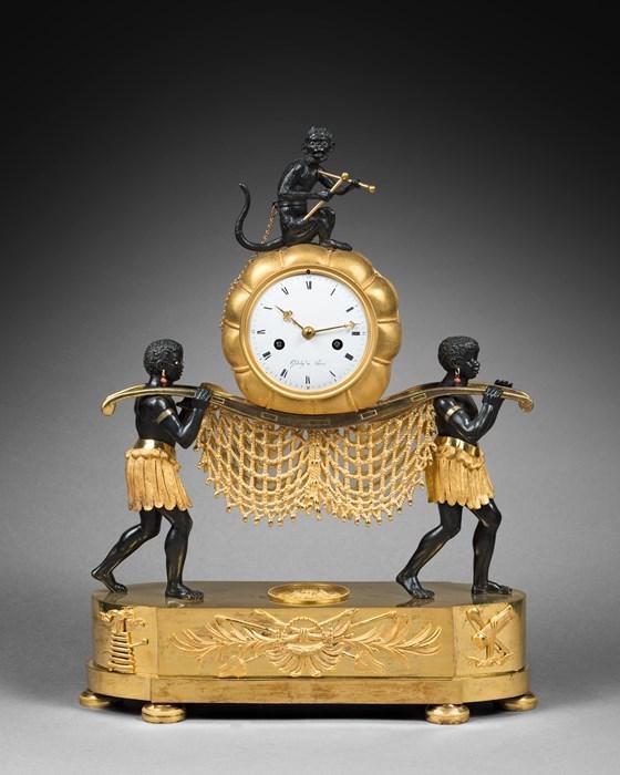"""Les pendules dites """"Au bon sauvage"""" et les créations de Jean-Simon Deverberie : L'Afrique et l'Amérique 63685511"""