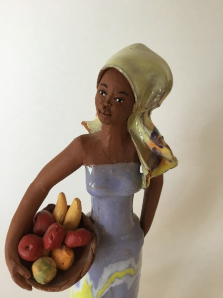 Studio pottery terracotta glazed figurine, woman with fruit 1eb55210