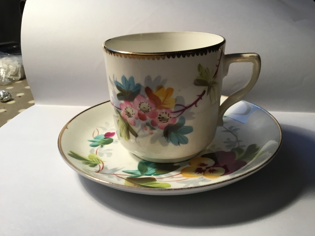 Porcelain pansies cup and saucer  31fd0610