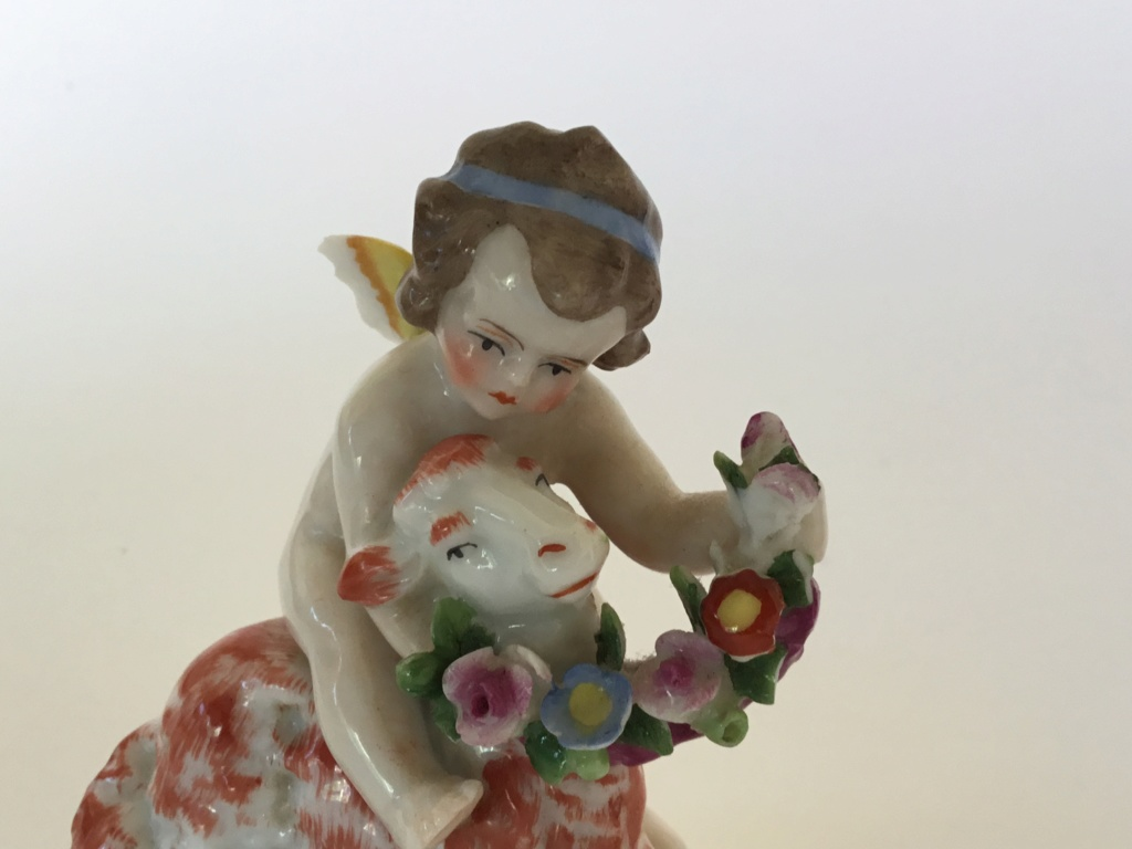 miniature porcelain cherub with lamb, bow arrow mark 47ed0210