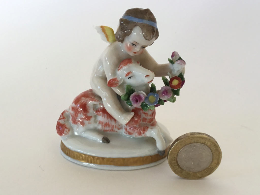 miniature porcelain cherub with lamb, bow arrow mark 660a6a10