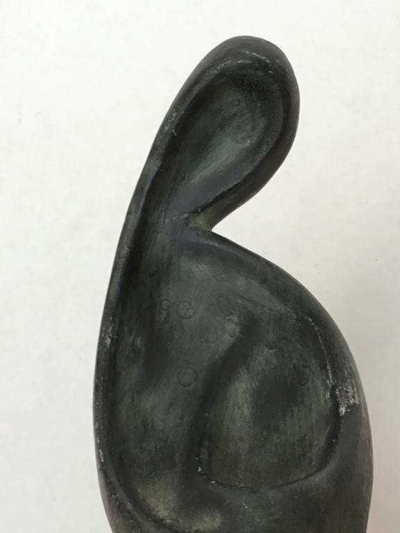 Modernist kneeling figurine 8d2ad410
