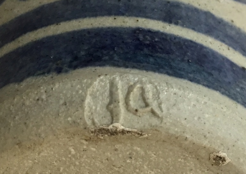Stoneware milk jug, ja  mark, blue flowers on grey oatmeal glaze Af1b4310
