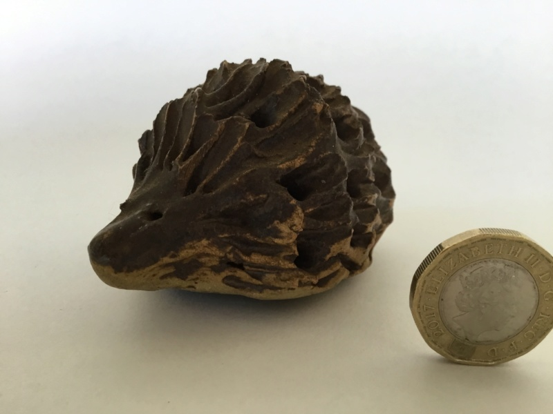 And a stoneware hedgehog, unmarked B4350810