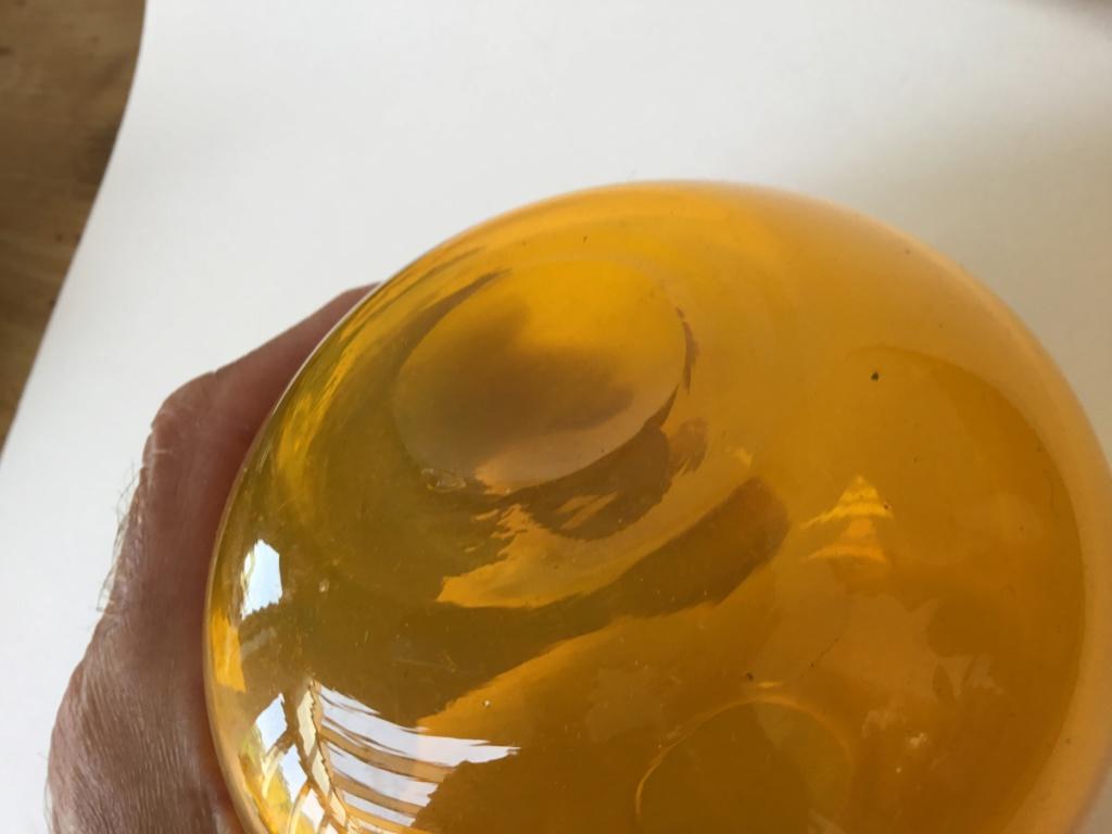 Heavy blown small orange globe vase C0ff4f10