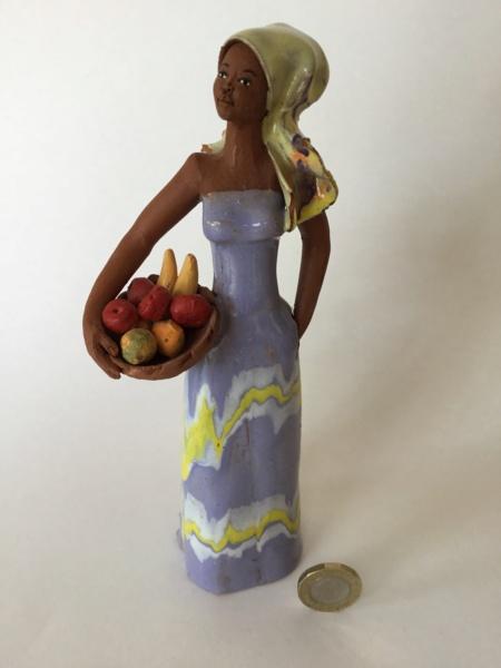 Studio pottery terracotta glazed figurine, woman with fruit C38b1c10