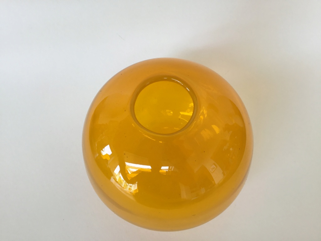 Heavy blown small orange globe vase De61eb10