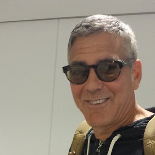 George Clooney on a plane to New York Plane_11