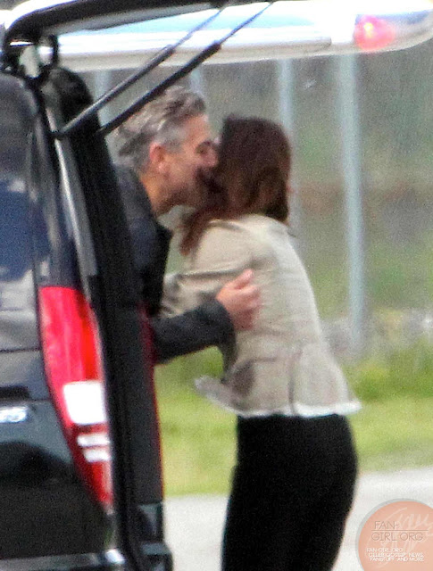 George Clooney leaves Como - and the mysterious kiss goodbye The_my19