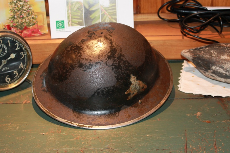 Lets see your favorite worn Canadian/Commonwealth helmets with nice aged patina Casque14