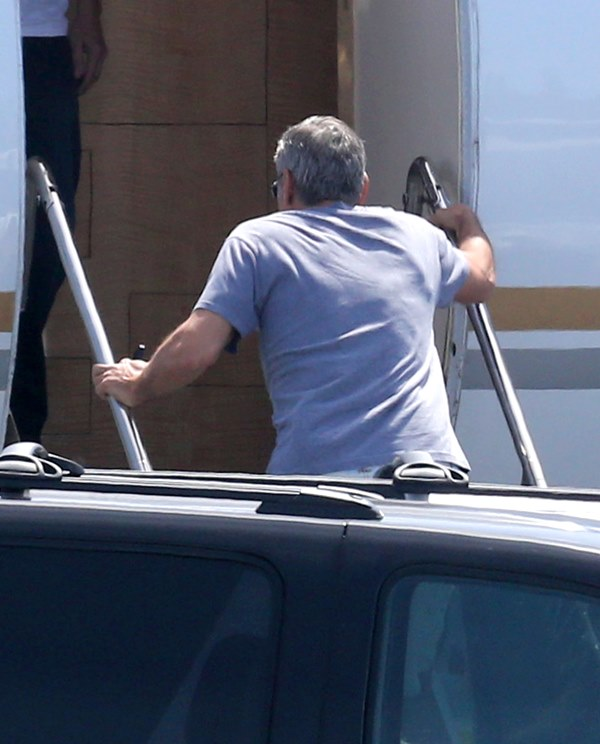 George Clooney and Amal leaving LA Air610