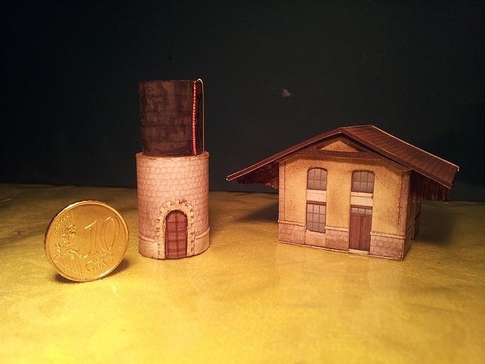 Château d'eau et hangar, ça fait 3 bâtiments.  Chatea10