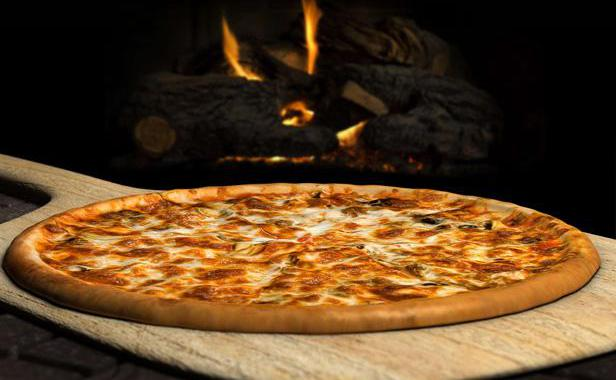A Rome, succès d'un restaurant qui emploie des trisomiques Pizza11