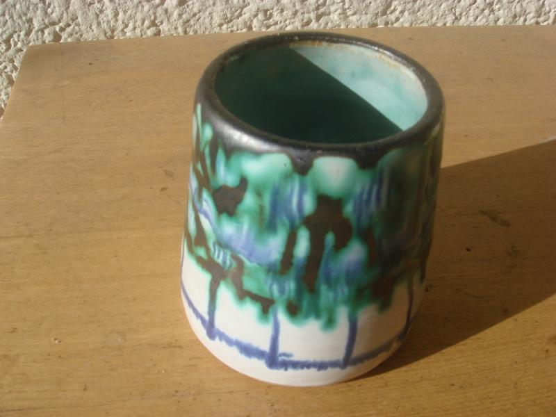 Amateur piece ?? 3.5 inches high...nice glaze...signed Bob_0110