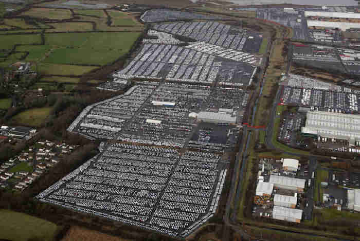 Hundreds of Thousands of Brand New Unsold Cars Parked Worldwide to Rot in Car Graveyards  Yu511