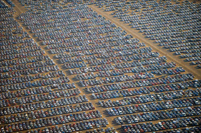 Hundreds of Thousands of Brand New Unsold Cars Parked Worldwide to Rot in Car Graveyards  Yu537710