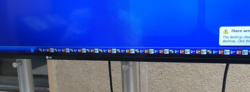 taskbar full with white,red and blue icons in your system tray (right-bottom of your screen). Icon11