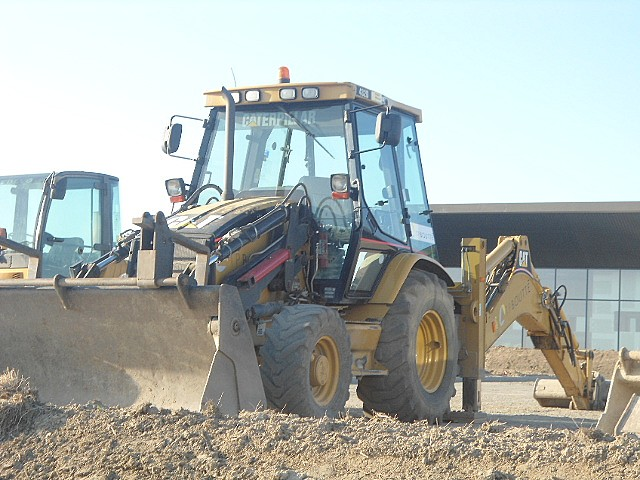Tractopelle Caterpillar (USA) Cat_310