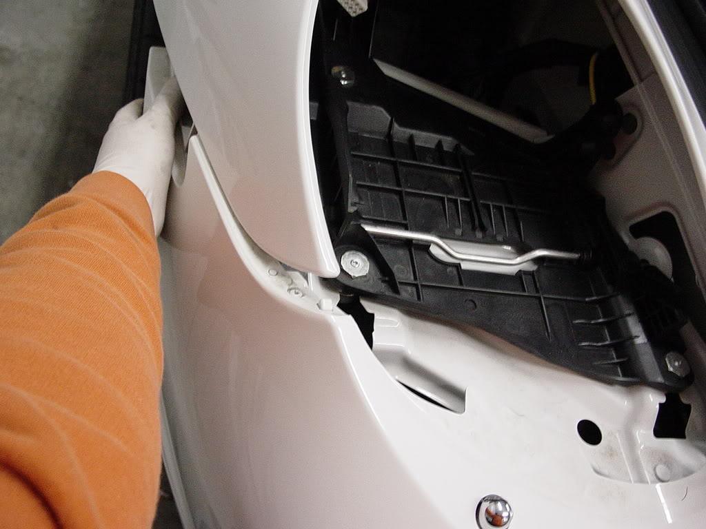 Démontage pare choc avant Porsche 997 Dsc03100