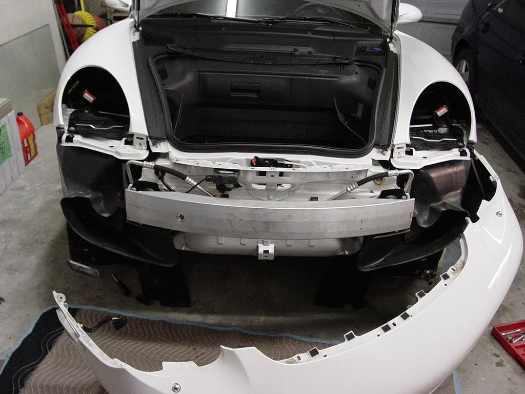 Démontage pare choc avant Porsche 997 Dsc03102