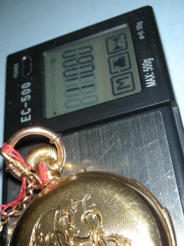 le poids de l'or dans un boitier  - Page 4 Dscn0414