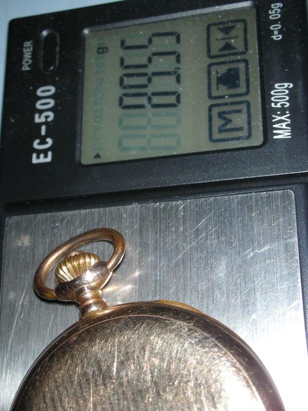 le poids de l'or dans un boitier  - Page 4 Dscn0415