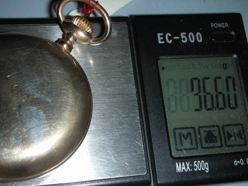 le poids de l'or dans un boitier  - Page 4 Dscn0417