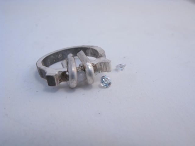 Bague argent serti bride de sept diamants de 2/100 ct - Page 2 Zircon10