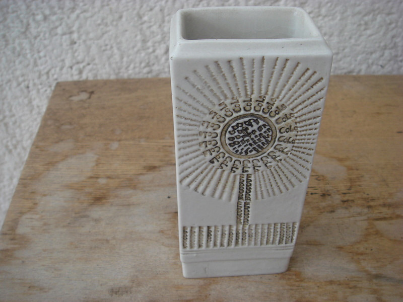 an odd little vase...the front appears to be typefaces..TK Maxx ? Copied58